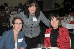photo of Kathy Friel with two attendees at annual event